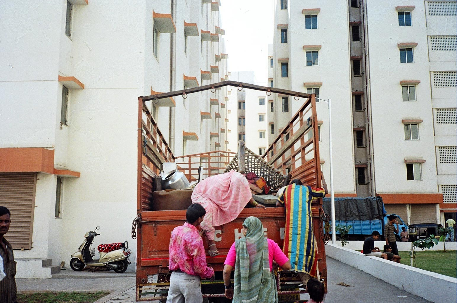 People moving into their new homes at Vashi Naka, Mumbai from settlements near the Railway tracks as part of the resettlement and rehabilitation program under the Mumbai Urban Transport Project (MUTP).