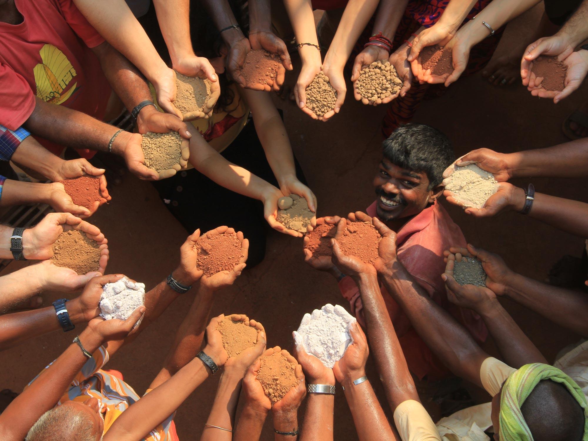 Hands of the Auroville Earth Institute's team. Credits: Lara Davis
