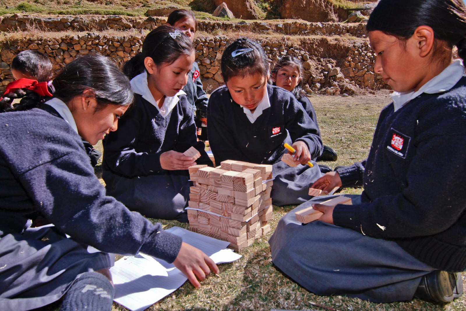 School children learn about the physics of earth shaking and safe construction as a part of training an entire community to better prepare for earthquakes. Image Credit: David Hermoza