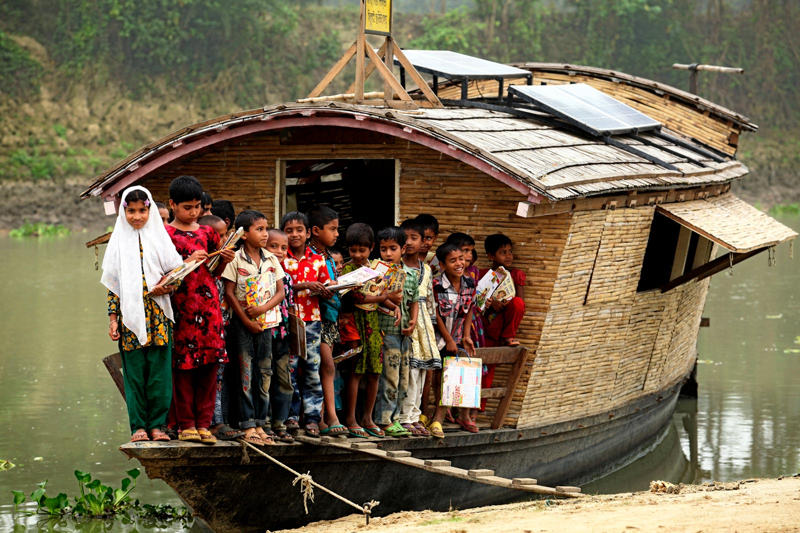 The school-boat travels to the children to provide basic primary education as the children can't travel to the school due to the lack of transportation during flooding in Bangladesh (Natore, 2013). Image Credit: Abir Abdullah/ Shidhulai Swanirvar